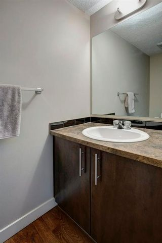 Photo 14: 106 2445 Kingsland Road SE: Airdrie Row/Townhouse for sale : MLS®# A1072510
