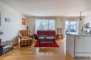 Photo 7: 112 Rocky Vista Circle NW in Calgary: Rocky Ridge Row/Townhouse for sale : MLS®# A1125808