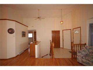 Photo 10: 31 RIVERVIEW Close: Cochrane House for sale : MLS®# C4055630