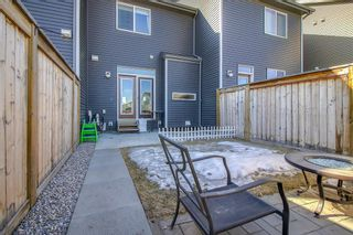 Photo 34: 100 Legacy Main Street SE in Calgary: Legacy Row/Townhouse for sale : MLS®# A1095155