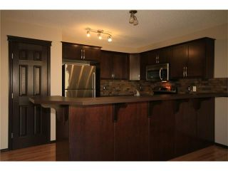 Photo 9: 81 SUNSET Heights: Cochrane House for sale : MLS®# C4072364