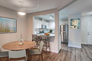 Photo 2: 106 1415 17 Street SE in Calgary: Inglewood Apartment for sale : MLS®# A1077781