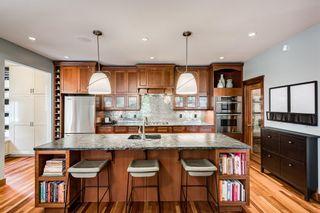 Photo 4: 5502 Henwood Street SW in Calgary: Garrison Green Detached for sale : MLS®# A1147829