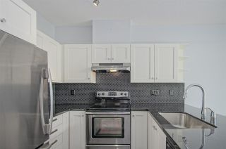 """Photo 7: 418 4550 FRASER Street in Vancouver: Fraser VE Condo for sale in """"CENTURY"""" (Vancouver East)  : MLS®# R2415916"""