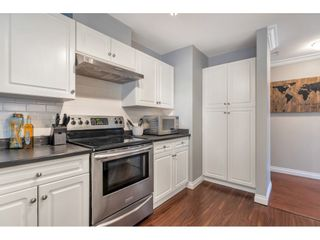 "Photo 14: 302 3176 GLADWIN Road in Abbotsford: Central Abbotsford Condo for sale in ""REGENCY PARK"" : MLS®# R2553395"