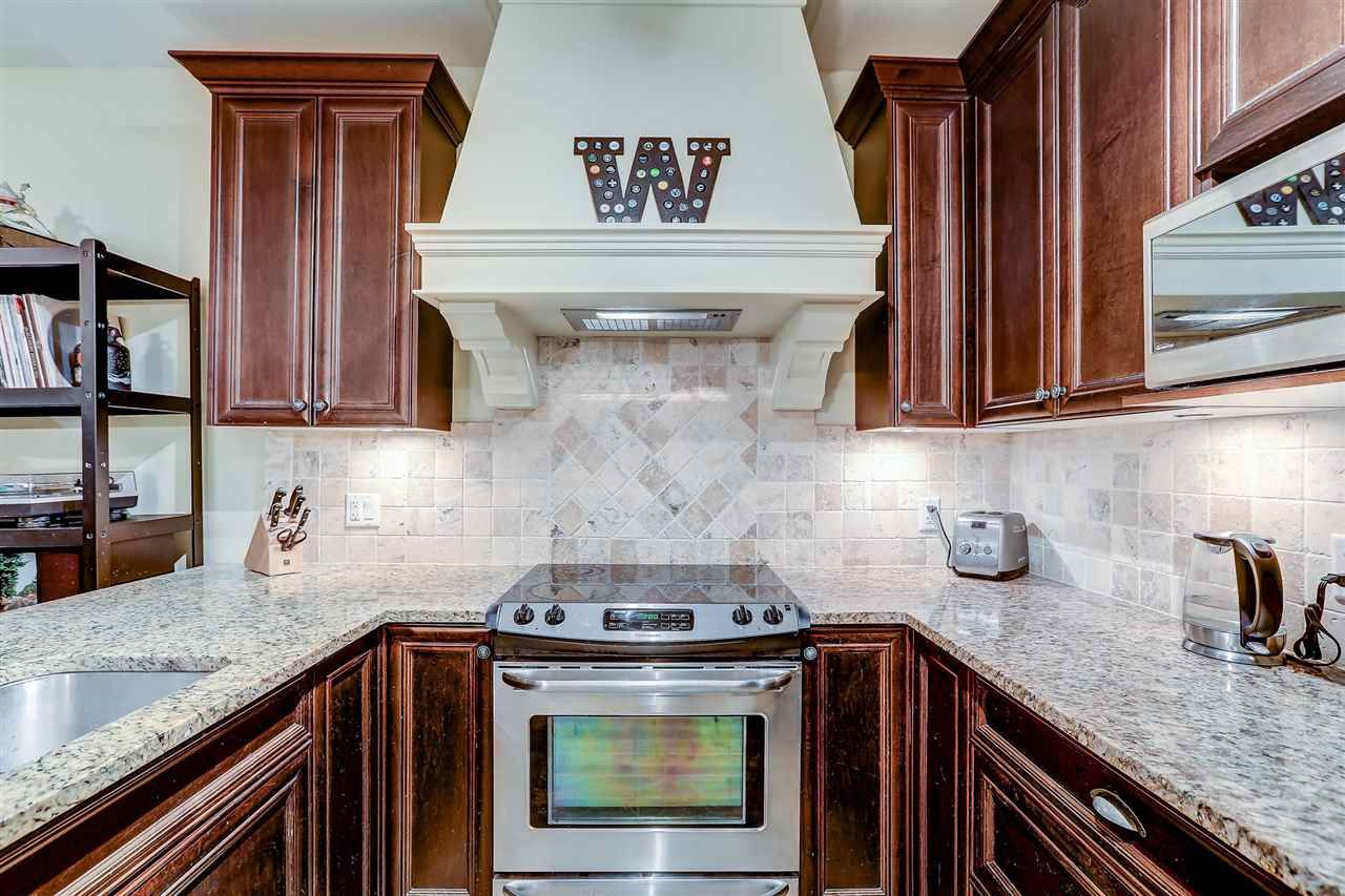 Main Photo: 103 19530 65 Avenue in Surrey: Clayton Condo for sale (Cloverdale)  : MLS®# R2518751