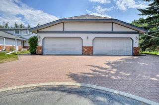 Photo 1: 20A Woodmeadow Close SW in Calgary: Woodlands Row/Townhouse for sale : MLS®# A1127050