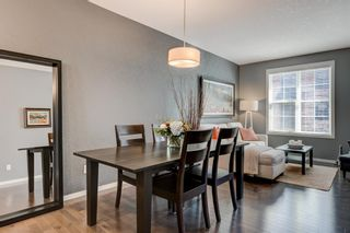 Photo 8: 440 Ascot Circle SW in Calgary: Aspen Woods Row/Townhouse for sale : MLS®# A1090678