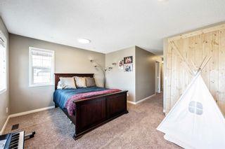 Photo 24: 494 Boulder Creek Way SE: Langdon Semi Detached for sale : MLS®# A1148702