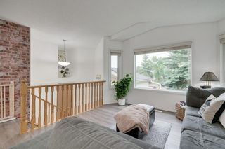 Photo 4: 144 SHAWINIGAN Drive SW in Calgary: Shawnessy Detached for sale : MLS®# A1131377