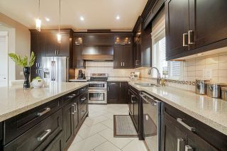 """Photo 12: 8119 211 Street in Langley: Willoughby Heights House for sale in """"YORKSON"""" : MLS®# R2553658"""
