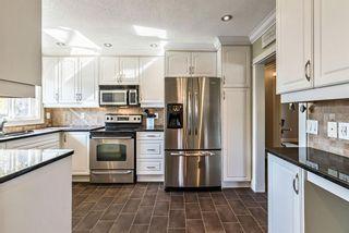 Photo 8: 11 Hogarth Crescent SW in Calgary: Haysboro Detached for sale : MLS®# A1150349