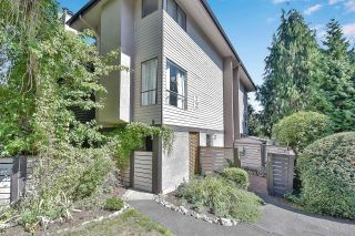 """Photo 1: 10524 HOLLY PARK Lane in Surrey: Guildford Townhouse for sale in """"Holly Park Lane"""" (North Surrey)  : MLS®# R2615553"""