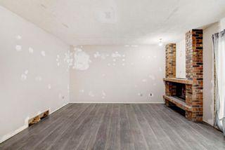 Photo 9: 132 Woodglen Way SW in Calgary: Woodbine Detached for sale : MLS®# A1134338