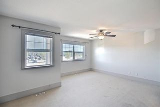 Photo 17: 63 Wentworth Common SW in Calgary: West Springs Row/Townhouse for sale : MLS®# A1124475