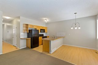 Photo 8: 94 Everridge Gardens SW in Calgary: Evergreen Row/Townhouse for sale : MLS®# A1069502