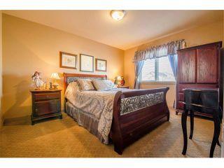 Photo 19: 21 STRATHRIDGE Way SW in Calgary: Strathcona Park House for sale : MLS®# C4000234