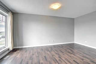 Photo 4: 49 Aspen Hills Drive in Calgary: Aspen Woods Row/Townhouse for sale : MLS®# A1108255