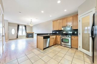 Photo 6: 2 720 56 Avenue SW in Calgary: Windsor Park Row/Townhouse for sale : MLS®# A1153375