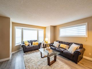 Photo 4: 27 Sandarac Road NW in Calgary: Sandstone Valley Row/Townhouse for sale : MLS®# A1148451