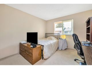"""Photo 11: 103 7349 140 Street in Surrey: East Newton Townhouse for sale in """"Newton Park"""" : MLS®# R2464654"""