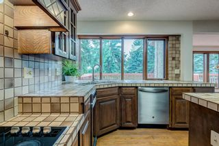 Photo 14: 331 Coach Light Bay SW in Calgary: Coach Hill Detached for sale : MLS®# A1132031