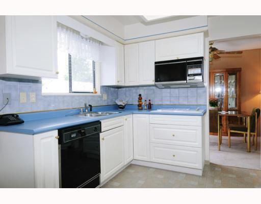 Photo 5: Photos: 1028 MAYWOOD Avenue in Port_Coquitlam: Lincoln Park PQ House for sale (Port Coquitlam)  : MLS®# V776918
