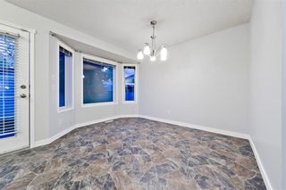 Photo 13: 167 BRIDLEWOOD CM SW in Calgary: Bridlewood House for sale