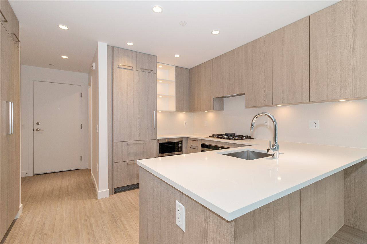 """Main Photo: 101 733 E 3RD Street in North Vancouver: Lower Lonsdale Condo for sale in """"Green on Queensbury"""" : MLS®# R2452551"""