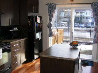 Photo 7: 203 2445 Kingsland Road SE: Airdrie Row/Townhouse for sale : MLS®# A1076272