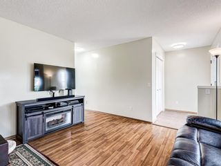 Photo 4: 159 COVEWOOD Park NE in Calgary: Coventry Hills Detached for sale : MLS®# A1083322