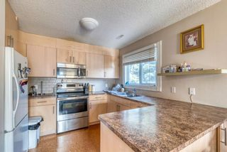 Photo 5: 51 3015 51 Street SW in Calgary: Glenbrook Row/Townhouse for sale : MLS®# A1054474