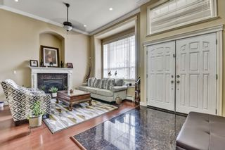 Photo 2: 7036 149 Street in Surrey: East Newton House for sale : MLS®# R2565142