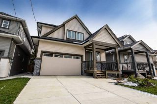 Photo 1: 11934 BLAKELY Road in Pitt Meadows: Central Meadows House for sale : MLS®# R2410127