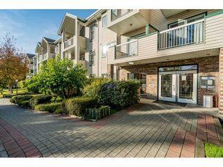 "Photo 1: 120 13911 70 Avenue in Surrey: East Newton Condo for sale in ""Canterbury Green"" : MLS®# R2520176"
