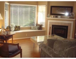 """Photo 2: 4 1195 FALCON Drive in Coquitlam: Eagle Ridge CQ Townhouse for sale in """"THE COURTYARDS"""" : MLS®# V775028"""