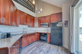 Photo 3: 114 6550 Old Banff Coach Road SW in Calgary: Patterson Apartment for sale : MLS®# A1045271