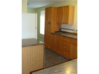 Photo 6: 30 ERIN RIDGE Place SE in CALGARY: Erinwoods Residential Detached Single Family for sale (Calgary)  : MLS®# C3602698