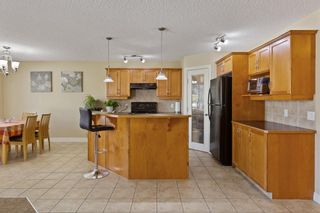 Photo 6: 228 BRIDLEWOOD Common SW in Calgary: Bridlewood Detached for sale : MLS®# A1034848