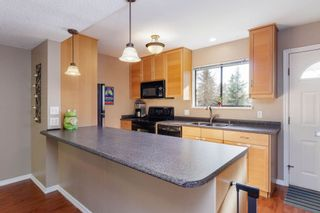 """Photo 6: 905 BRITTON Drive in Port Moody: North Shore Pt Moody Townhouse for sale in """"WOODSIDE VILLAGE"""" : MLS®# R2457346"""