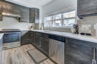 Photo 10: 135 NOLANCREST Common NW in Calgary: Nolan Hill Row/Townhouse for sale : MLS®# A1105271
