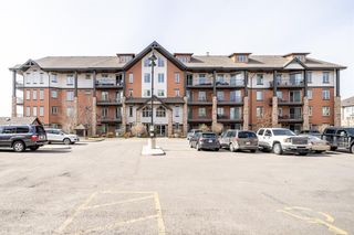 Photo 1: 2310 15 Sunset Square: Cochrane Apartment for sale : MLS®# A1088387