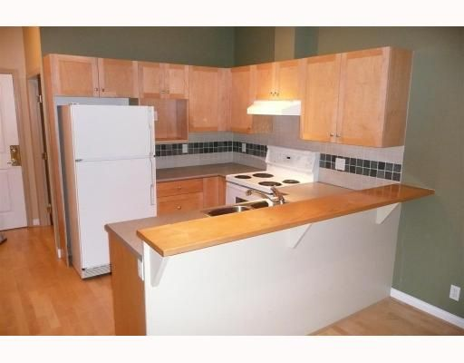 """Photo 5: Photos: 110 1675 W 10TH Avenue in Vancouver: Fairview VW Condo for sale in """"NORFOLK HOUSE"""" (Vancouver West)  : MLS®# V668536"""