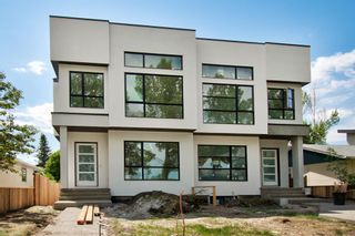 Photo 1: 2409 52 Avenue SW in Calgary: North Glenmore Park Semi Detached for sale : MLS®# A1123926