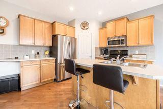 Photo 6: 403 CIMARRON Boulevard: Okotoks House for sale : MLS®# C4170215