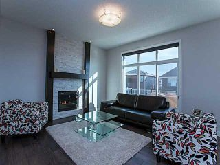 Photo 4: 55 SUNSET Parkway: Cochrane House for sale : MLS®# C3651244