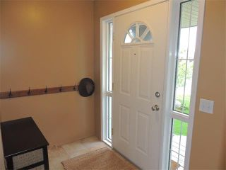 Photo 3: 105 MILLRISE Square SW in Calgary: Millrise House for sale : MLS®# C4014169