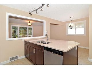Photo 9: 70 CAMBRIAN Drive NW in Calgary: Bungalow for sale : MLS®# C3538395