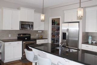 Photo 3: 377 River Heights Drive: Cochrane Detached for sale : MLS®# A1106134