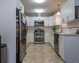 Photo 4: 104 4699 Muir Rd in : CV Courtenay East Row/Townhouse for sale (Comox Valley)  : MLS®# 870188